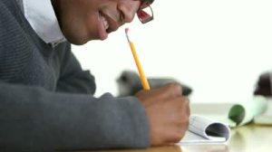 stock-footage-african-american-business-man-writing-with-pencil